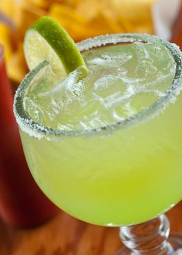 Frozen margarita with lime and frosted rim
